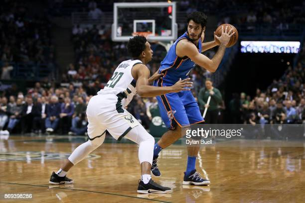 Alex Abrines of the Oklahoma City Thunder handles the ball while being guarded by Rashad Vaughn of the Milwaukee Bucks in the first quarter at the...