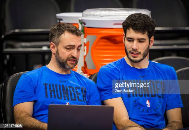 Alex Abrines of the Oklahoma City Thunder reviews materials prior to the game against the Sacramento Kings on December 19, 2018 at Golden 1 Center in...