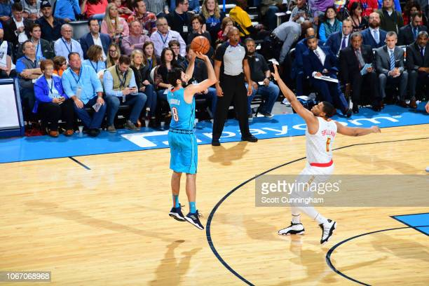 Alex Abrines of the Oklahoma City Thunder shoots a threepointer against the Atlanta Hawks on November 30 2018 at Chesapeake Energy Arena in Oklahoma...