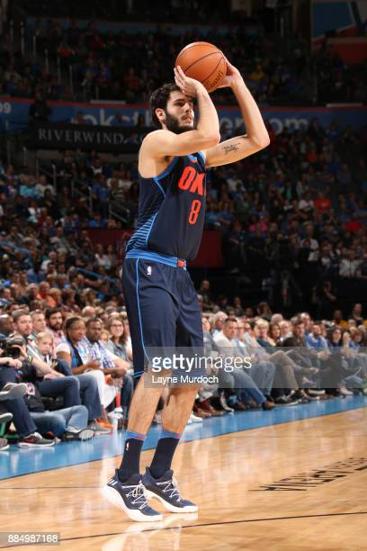 Alex Abrines of the Oklahoma City Thunder shoots the ball against the San Antonio Spurs on December 3 2017 at Chesapeake Energy Arena in Oklahoma...