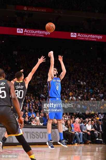 Alex Abrines of the Oklahoma City Thunder shoots the ball against the Golden State Warriors on February 6 2018 at ORACLE Arena in Oakland California...