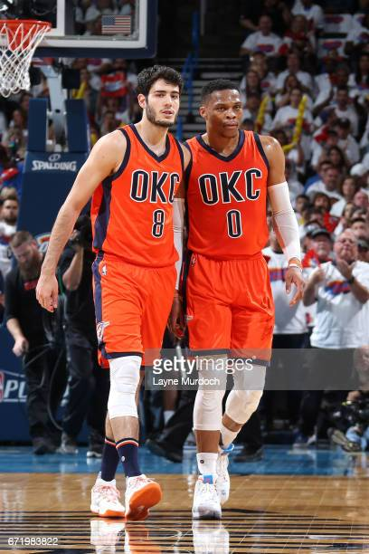 Alex Abrines of the Oklahoma City Thunder talks with Russell Westbrook of the Oklahoma City Thunder during the game against the Houston Rockets in...