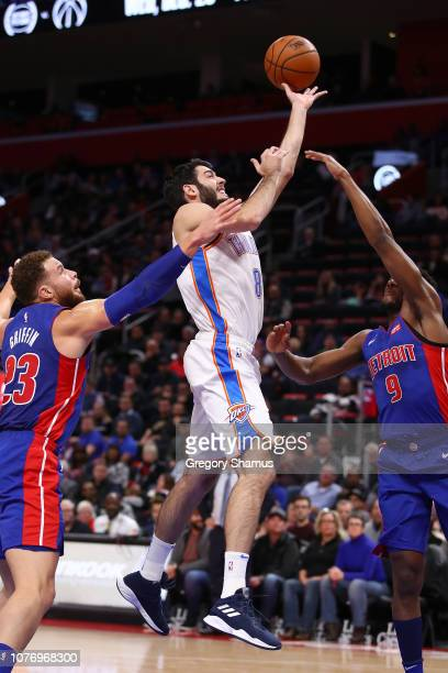 Alex Abrines of the Oklahoma City Thunder tries to get a shot off between Langston Galloway and Blake Griffin of the Detroit Pistons during the first...