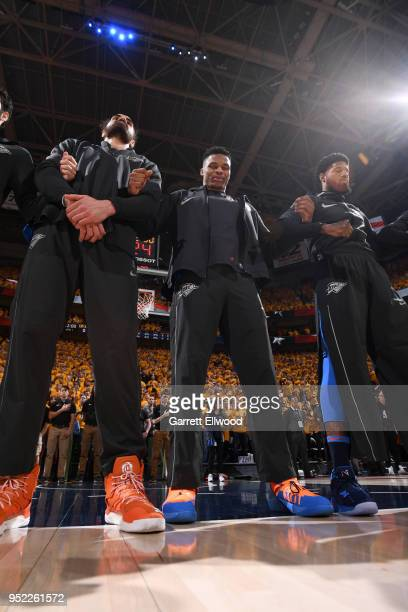 Alex Abrines Steven Adams Russell Westbrook and Paul George of the Oklahoma City Thunder stand for the National Anthem before Game Six of the Western...