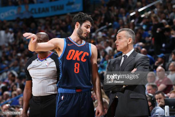 Alex Abrines talks with Head Coach Billy Donovan of the Oklahoma City Thunder during the game against the Minnesota Timberwolves on December 23, 2018...