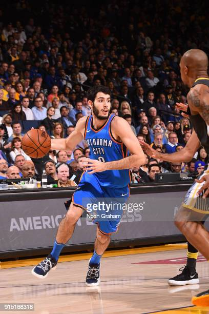 Alex Abrines the Oklahoma City Thunder handles the ball against the Golden State Warriors on February 6 2018 at ORACLE Arena in Oakland California...