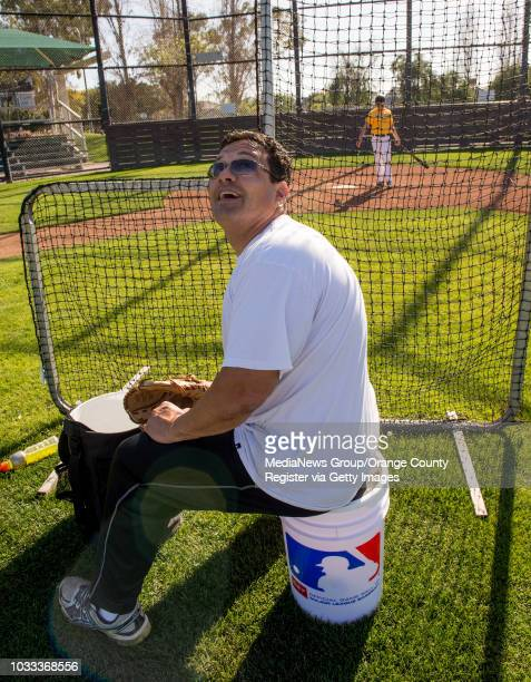 Alex Acevedo left turns to watch where his son Austin hit the ball during batting practice as the Newport Beach Little League resumed their schedule...