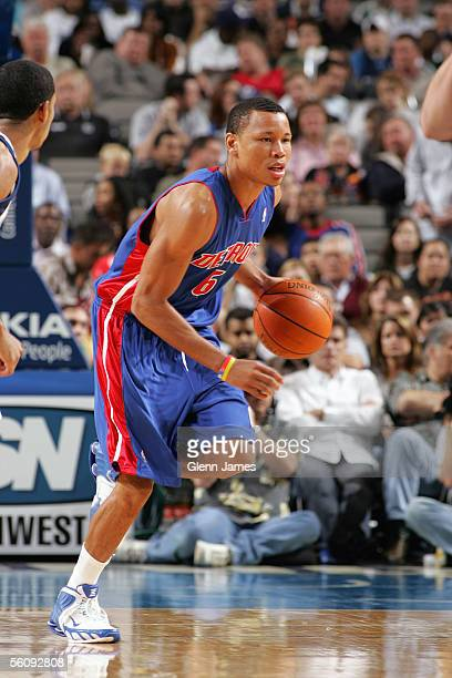 Alex Acker of the Detroit Pistons brings the ball upcourt during the preseason game against the Dallas Mavericks at American Airlines Arena on...