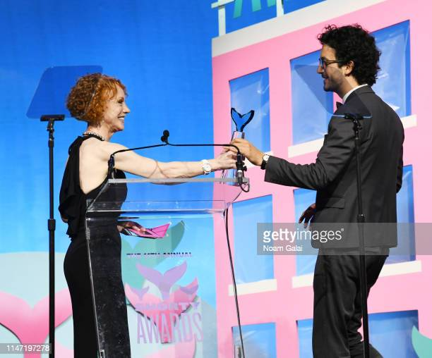 Alex Ainouz receives an award from Kathy Griffin onstage during the 11th Annual Shorty Awards on May 05 2019 at PlayStation Theater in New York City