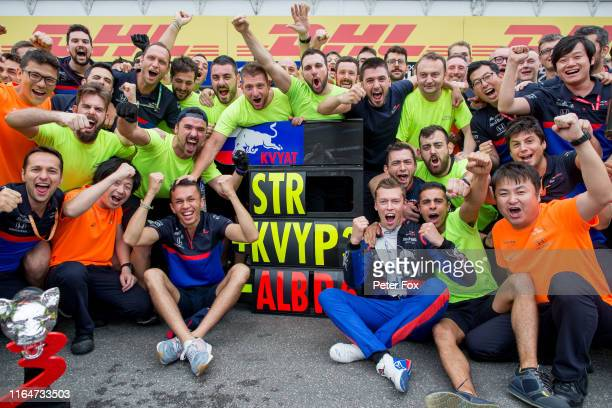 Alex Albon of Scuderia Toro Rosso and Thailand and Daniil Kvyat of Scuderia Toro Rosso and Russia with the team celebrate finishing 3rd and 6th...