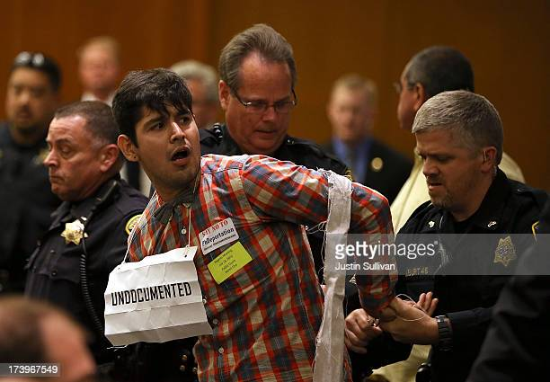 Alex Aldana is arrested by University of California police officers after he protested against the nomination of Janet Napolitano the Department of...