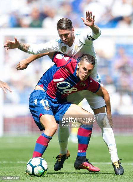 Alex Alegria of Levante UD is challenged by Sergio Ramos of Real Madrid CF during the La Liga match between Real Madrid and Levante at Estadio...