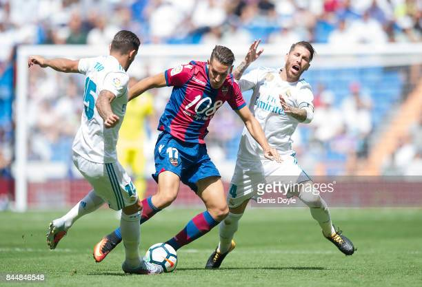 Alex Alegria of Levante UD is challenged by Theo Hernandez and Sergio Ramos of Real Madrid CF during the La Liga match between Real Madrid and...