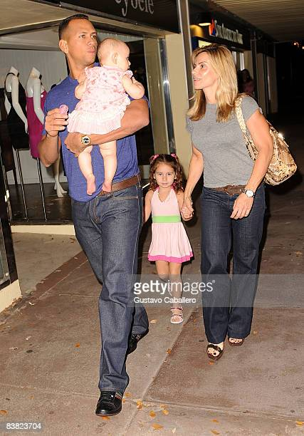Alex and Cynthia Rodriguez and their children Ella Alexander and Natasha Alexander at Houstons on November 25 2008 in Miami Florida