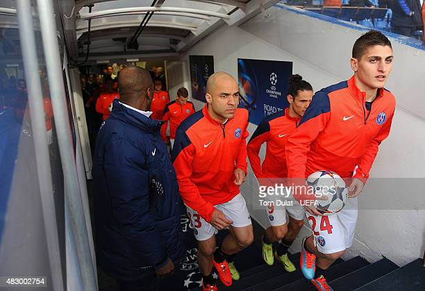 Alex and Marco Verratti of PSG make their way out of the tunnel during the UEFA Champions League Quarter Final second leg match between Chelsea and...