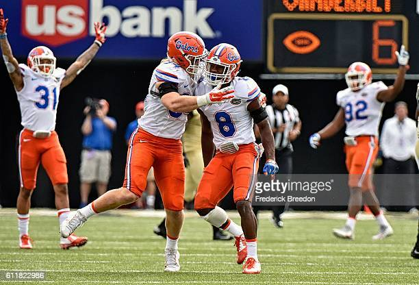 Alex Anzalone of the Florida Gators celebrates with teammate Nick Washington after an interception against the Vanderbilt Commodores during the...
