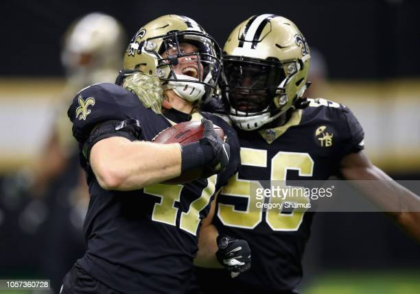 Alex Anzalone of the New Orleans Saints celebrates an interception with teammate Demario Davis during the second quarter of the game against the Los...
