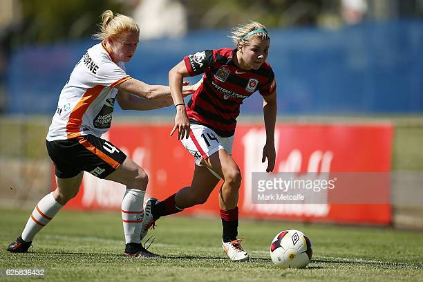 Alex Arlitt of the Wanderers takes on Clare Polkinghorne of the Roar during the round four WLeague match between the Western Sydney Wanderers and the...