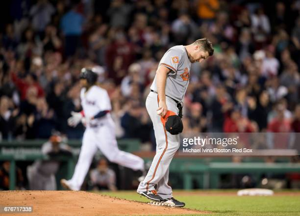 Alex Asher of the Baltimore Orioles reacts after allowing a home run to Hanley Ramirez of the Boston Red Sox in the sixth inning at Fenway Park on...