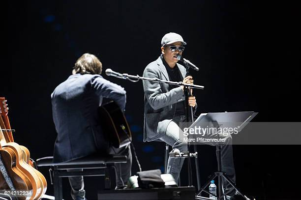 Alex Auer and Xavier Naidoo perform onstage during the Nicht von dieser Welt Tour at the Lanxess Arena on November 18 2016 in Cologne Germany