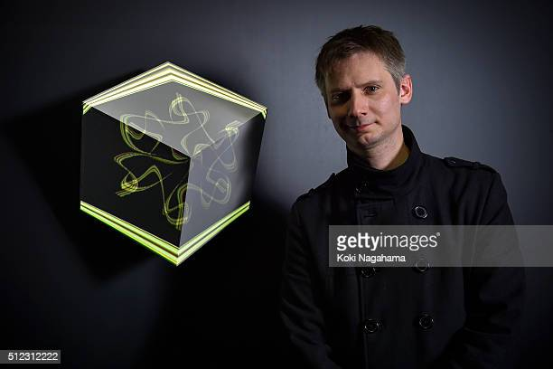 Alex Augier poses a photograph in front of his artwork 'vVvoxel' during the Media Ambition Tokyo 2016 at VENUE on February 25 2016 in Tokyo Japan...