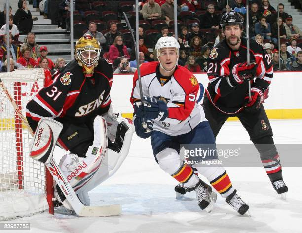Alex Auld and Jason Smith of the Ottawa Senators focus on the play with Brett McLean of the Florida Panthers at Scotiabank Place on December 8 2008...