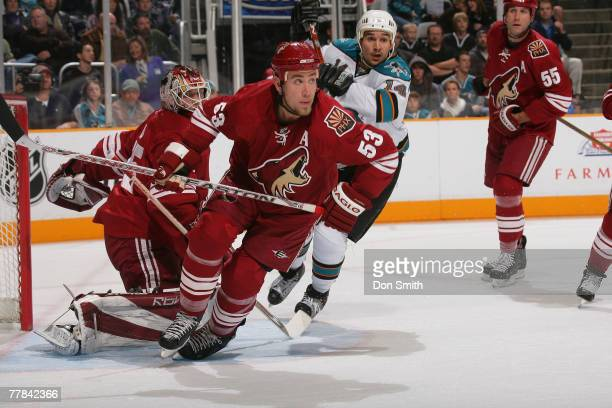 Alex Auld, Derek Morris, Ed Jovanovski of the Phoenix Coyotes and Jonathan Cheechoo of the San Jose Sharks watches the action during an NHL game on...