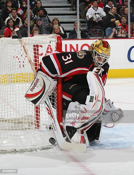 Alex Auld of the Ottawa Senators makes a save against the Pittsburgh Penguins at Scotiabank Place on December 6, 2008 in Ottawa, Ontario, Canada.