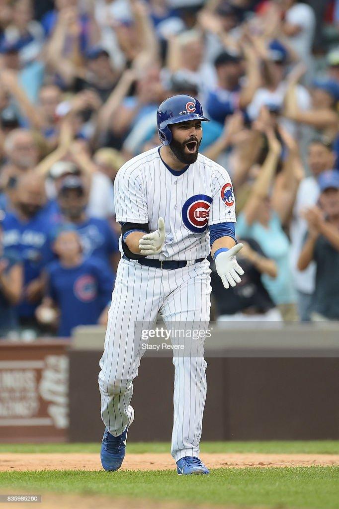 Alex Avila #13 of the Chicago Cubs celebrates after hitting a walk off single to defeat the Toronto Blue Jays in the bottom of the 10th inning at Wrigley Field on August 20, 2017 in Chicago, Illinois. The Cubs defeated the Blue Jays 6-5.