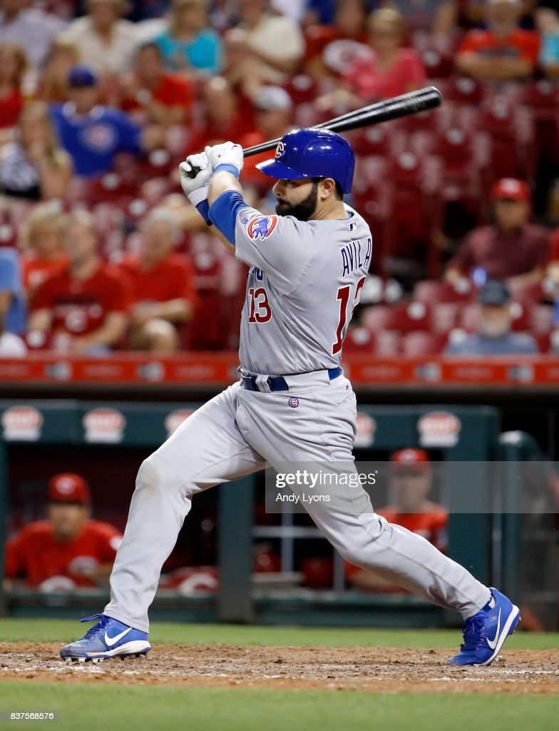 Alex Avila #13 of the Chicago Cubs hits a run scoring single in the 8th inning against the Cincinnati Reds at Great American Ball Park on August 22, 2017 in Cincinnati, Ohio.