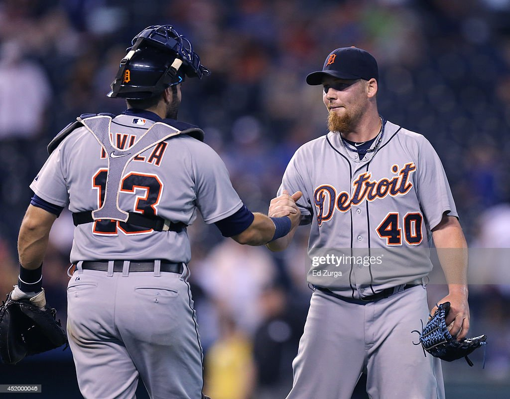 Alex Avila #13 of the Detroit Tigers and Phil Coke #40 celebrate a 16-4 win over the Kansas City Royals at Kauffman Stadium on July 10, 2014 at Kauffman Stadium in Kansas City, Missouri.