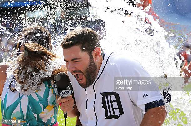 Alex Avila of the Detroit Tigers celebrates as his teammates dump the water bucket over his head after hitting the game game winning single to left...