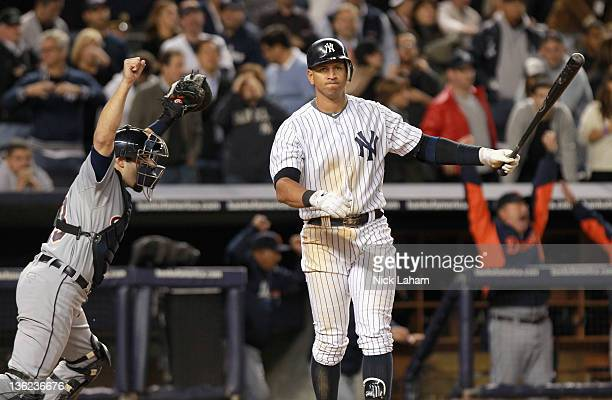Alex Avila of the Detroit Tigers celebrates the Tigers 32 win as Alex Rodriguez of the New York Yankees reacts after striking out for the games final...