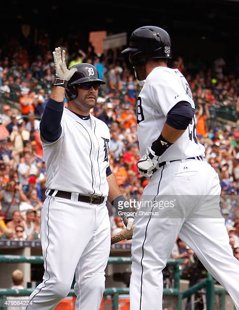 Alex Avila of the Detroit Tigers high fives JD Martinez after Martinez's sixthinning home run against the Toronto Blue Jays at Comerica Park on July...
