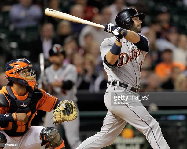 Alex Avila of the Detroit Tigers hits a tworun home run in the ninth inning against the Houston Astros as catcher Carlos Corporan of the Houston...