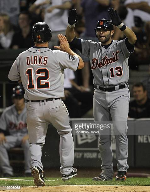 Alex Avila of the Detroit Tigers welcomes Andy Dirks as he scores the winning run in the 8th inning against the Chicago White Sox at US Cellular...