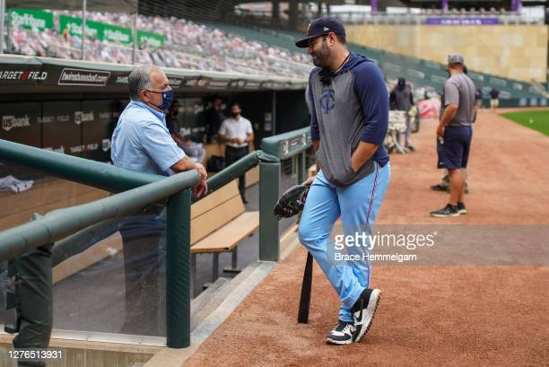September 23: Alex Avila of the Minnesota Twins talks with general manager Al Avila of the Detroit Tigers on September 23, 2020 at Target Field in...