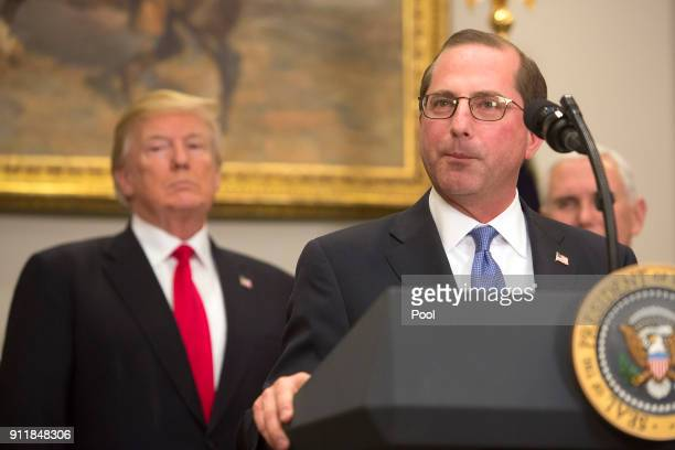 Alex Azar new Secretary of the Department of Health and Human Services speaks after being sworn in as President Donald J Trump looks on January 29...