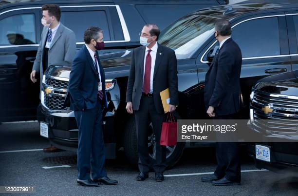 Alex Azar, outgoing secretary of Health and Human Services , center, departs from the White House on January 19, 2021 in Washington, DC. According to...