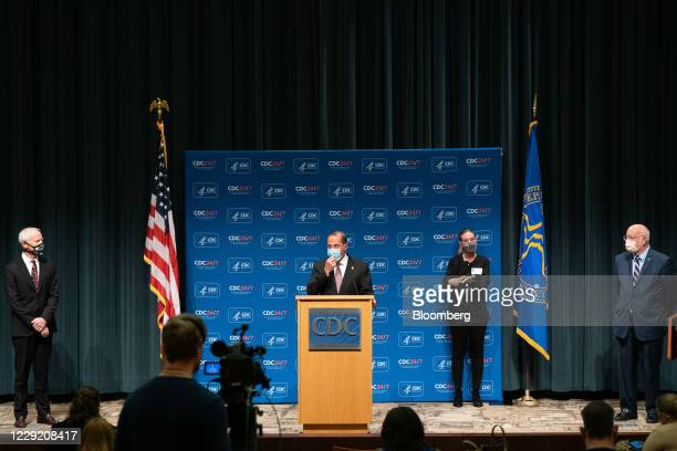 Alex Azar, secretary of Health and Human Services , center, speaks while Robert Redfield, director of the Centers for Disease Control and Prevention...