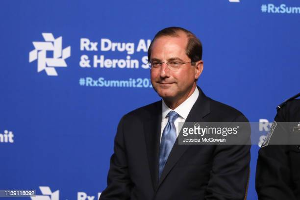 Alex Azar Secretary of Health and Human Services listens to President Donald Trump speak at the Rx Drug Abuse Heroin Summit on April 24 2019 in...