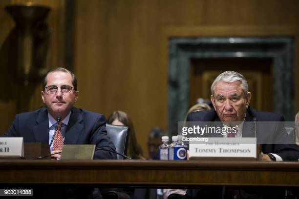 Alex Azar secretary of Health and Human Services nominee for US President Donald Trump left and Tommy Thompson former secretary of HHS listen during...