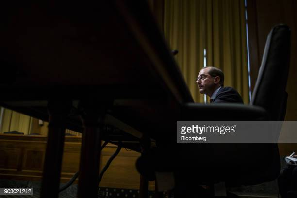Alex Azar secretary of Health and Human Services nominee for US President Donald Trump listens during a Senate Finance Committee confirmation hearing...
