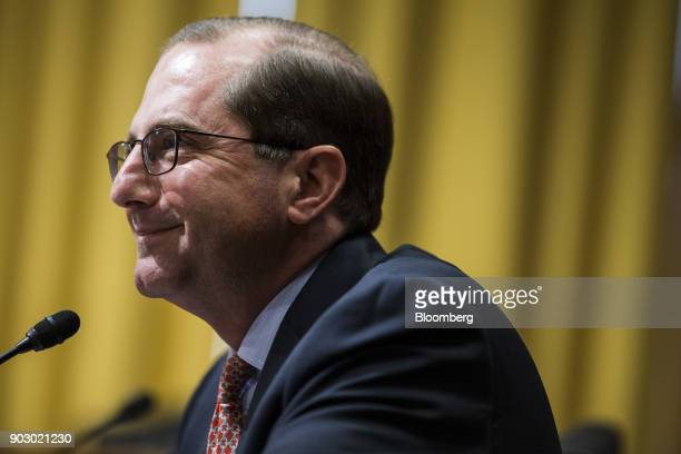 Alex Azar secretary of Health and Human Services nominee for US President Donald Trump smiles during a Senate Finance Committee confirmation hearing...