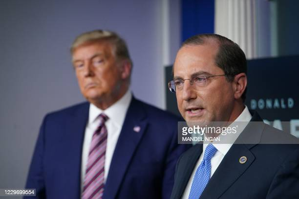 Alex Azar, secretary of Health and Human Services , speaks as President Donald Trump listens during an event on lowering prescription drug prices on...