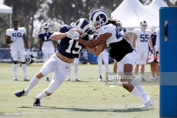Alex Bachman of the Los Angeles Rams and Ramon Richards of the Los Angeles Rams run through a drill during the fourth day of training camp on July 30...