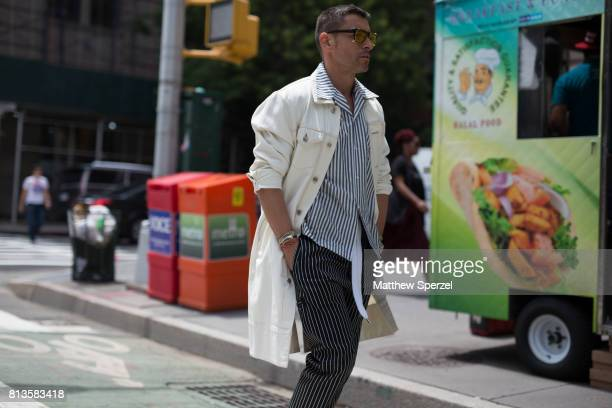 Alex Badia is seen attending Deveaux at EN Japanese Brasserie during Men's New York Fashion Week wearing a long white coat with striped outfit on...