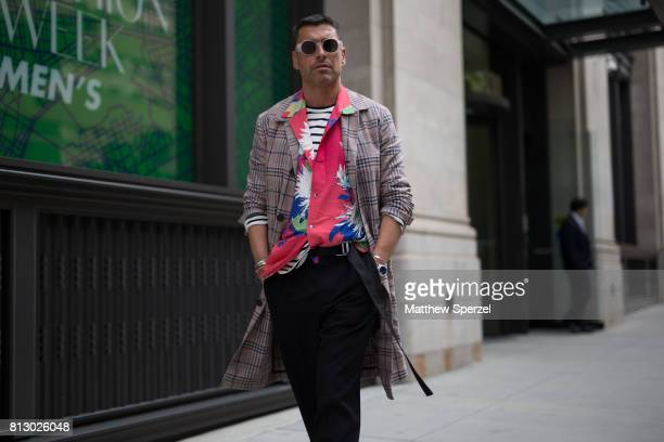 Alex Badia is seen attending Dyne during Men's New York Fashion Week wearing a plaid long jacket with colorful shirt on July 11 2017 in New York City