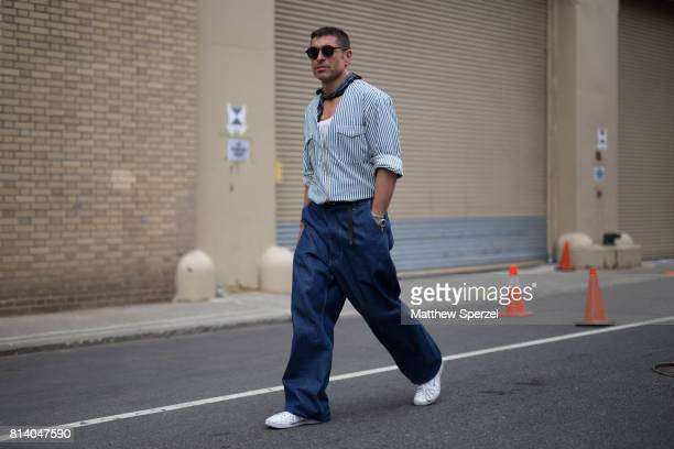 Alex Badia is seen attending General Idea Raun LaRose during Men's New York Fashion Week wearing denim with a bandana on July 13 2017 in New York City