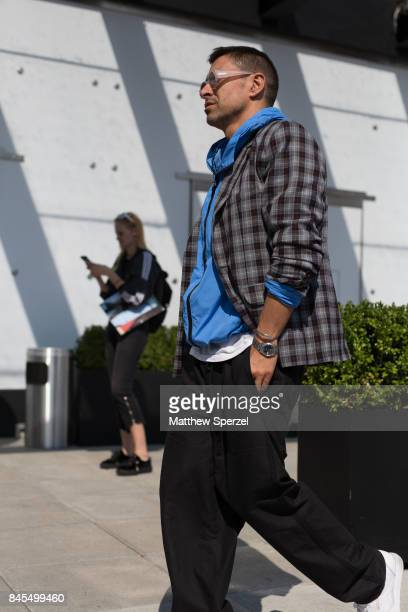 Alex Badia is seen attending Public School during New York Fashion Week wearing a blue jacket with plaid coat and black pants on September 10 2017 in...